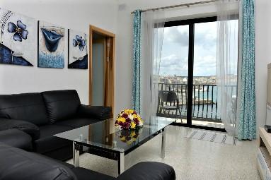 GV Maltaの学生用シェアアパートportobelloのリビングルーム