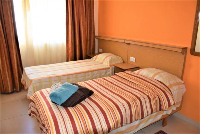 Clubclass Maltaの学生用アパートメント内ベッドルーム